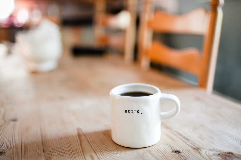 "Coffee mug with the word ""Begin"""